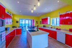 Gourmet Kitchen overlooks the relaxing poolside Caribbean room. Casa Música del Caribe